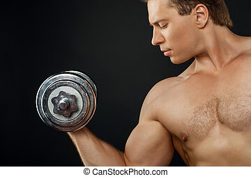 Handsome young man is exercising with iron equipment