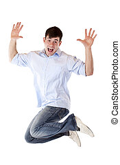 Handsome young man jumps in the air out of joy.Isolated on...