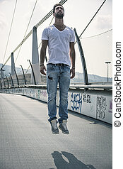 """Handsome young man """"levitating"""" in mid-air outdoors in urban..."""