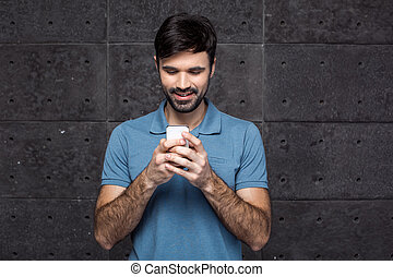 Handsome young man on grey background