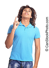 Handsome young man pointing up against white background - ...