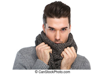 Handsome young man posing with gray wool scarf