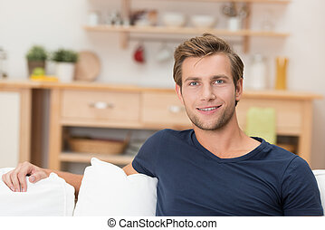 Handsome young man relaxing at home