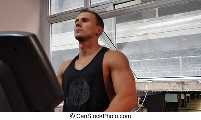 Handsome young man running on treadmill - Attractive young...