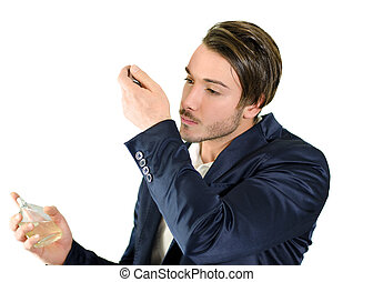 Handsome young man smelling perfume or cologne - Attractive ...