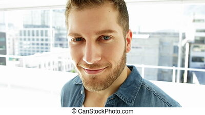 Handsome young man smiling at camera