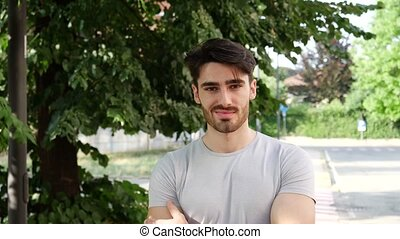 Handsome young man smiling outdoor