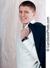 Handsome young man studio portrait