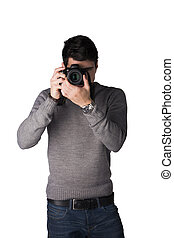 Handsome young man taking photo with professional photocamera