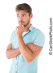 Handsome young man thinking with hand on chin on white ...