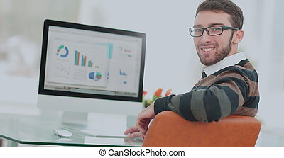 Handsome young man wearing glasses and working with modern ...