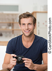 Handsome young man with a camera