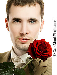 Handsome young man with a rose