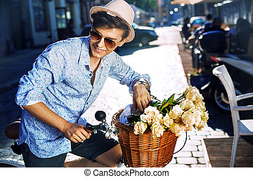 Handsome young man with a stylish bike