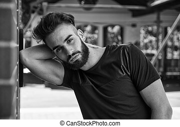 Handsome young man with beard outdoor
