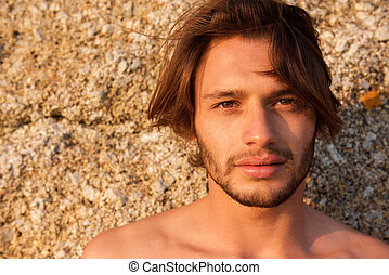 Handsome young man with beard shirtless