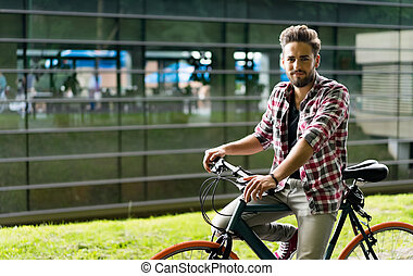 Handsome young man with his retro bike