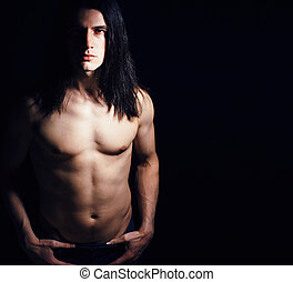 handsome young man with long hair