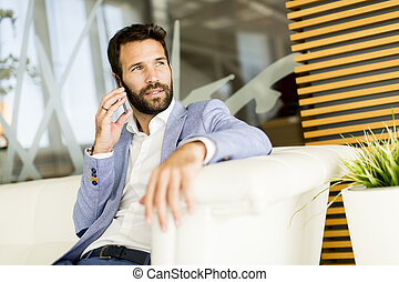 Handsome young man with mobile phone
