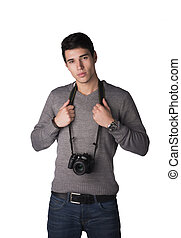 Handsome young man with professional photo camera