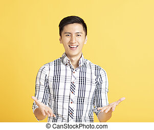 handsome young man with showing gesture