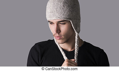 Handsome young man with wool hat