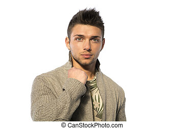 Handsome young man with wool sweater on white background