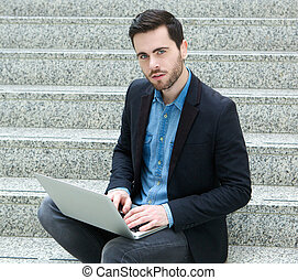 Handsome young man working on laptop