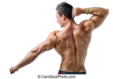 attractive young muscle man sunbathing on rock handsome young