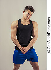 Handsome young muscular man looking at camera