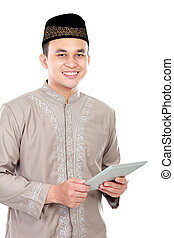 young muslim man holding a tablet - handsome young muslim...