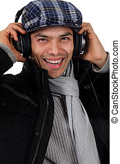 Handsome young nepalese man, headphones