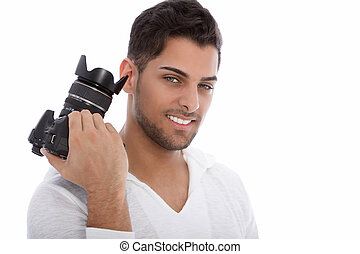 Handsome young photographer holding a camera