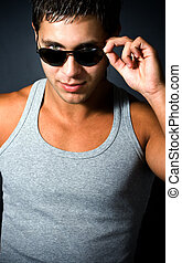 Handsome young sexy man with sunglasses