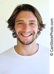 Handsome young smiling man with beard