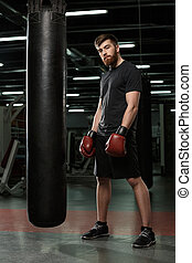 Handsome young strong sports man boxer