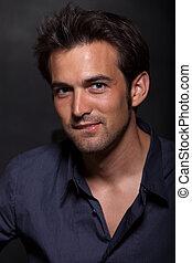 Handsome young twenties dark haired man