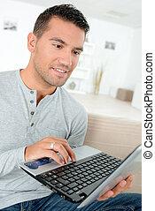 handsomen man with laptop