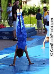 Boy at summer gymnastic camp