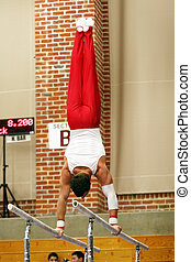 Handstand - Gymnast competing on parallel bars