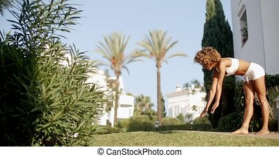 Handstand On The Lawn. - Girl doing a handstand on grass...