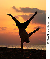 Handstand - Young man is doing an amazing handstand at...