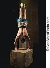 Handstand push-up man workout at gym pus ups