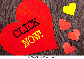Handwriting Announcement text showing Click Now. Concept meaning Sign Book Or Register Banner For Join Apply written on Heart Love on the wooden background.