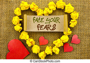 Handwriting Announcement text showing Face Your Fears. Concept meaning Challenge Fear Fourage Confidence Brave Bravery written on Sticky Note Paper With Heart on the textured background