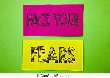 Handwriting Announcement text showing Face Your Fears. Conceptual photo Challenge Fear Fourage Confidence Brave Bravery written on sticky note paper on the green background.