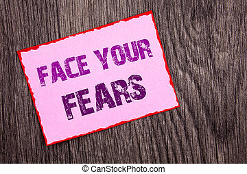 Handwriting Announcement text showing Face Your Fears. Conceptual photo Challenge Fear Fourage Confidence Brave Bravery written on Pink Sticky Note Paper on the wooden background.