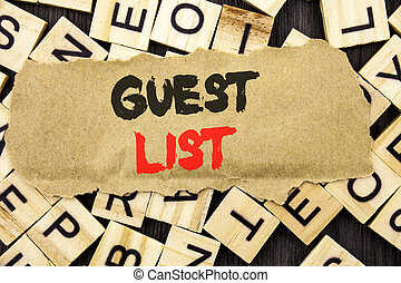 Handwriting Announcement text showing Guest List. Concept meaning Planning Wedding Or Event Important Guests Lists written on tear paper note on the letter and wood background.