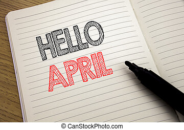 Handwriting Announcement text showing Hello April. Business concept for Spring Welcome written on notebook with copy space on book background with marker pen