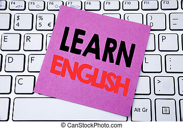 Handwriting Announcement text showing Learn English. Business concept for Language School written on sticky note paper on the white keyboard background.